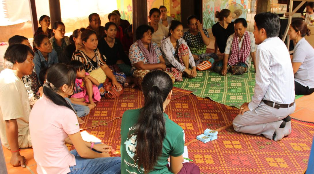 Volunteers run a training session for women who'd like to start their own businesses in Cambodia